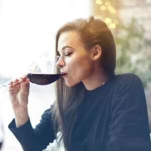 Features partners section image of a girl tasting a glass of wine